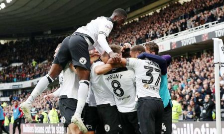 Derby County players celebrate.