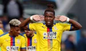 Wilfred Zaha scores for Crystal Palace against Huddersfield.