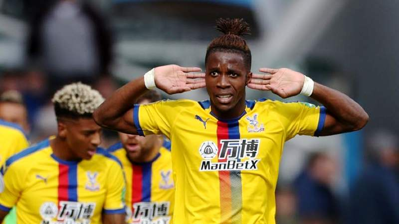 Wilfred Zaha celebrates after scoring for Crystal Palace against Huddersfield.